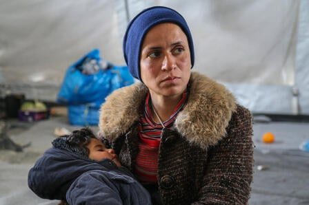 A mother and child stranded in Greece in a shelter at a refugee site.