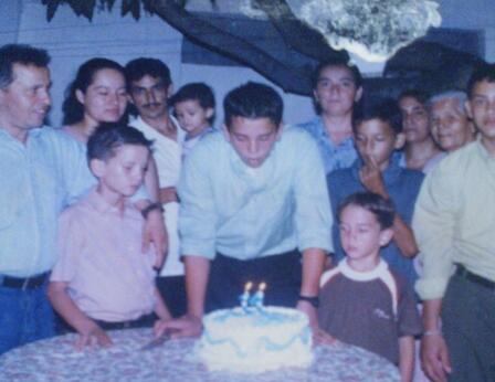 Suahmirs about to blow out the candles on his cake at a party for his 14th birthday in Honduras