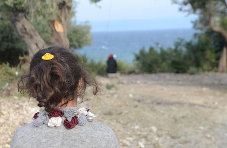 Seven-year-old Mubarak, a refugee on the island of Lesbos, looks out to sea.