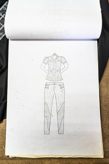 One of Lincy's skateches, showing her design for a jeans and blouse outfit
