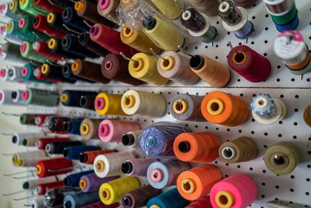 Spools of thread in Lincy's home workshop