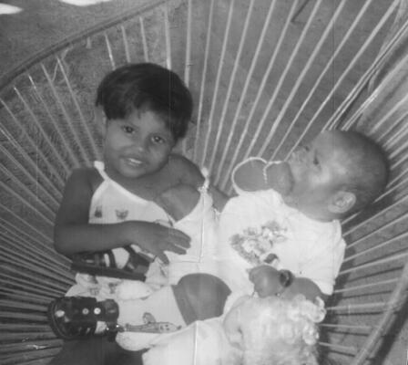 DACA recipient Lupe at age 2 with her baby brother