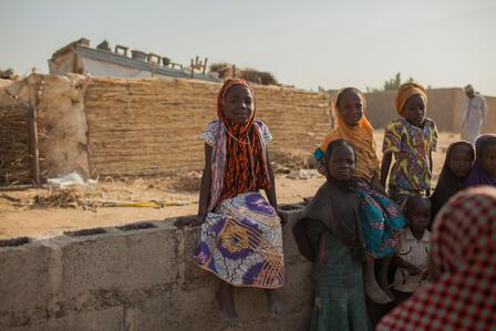 Displaced children pause their playing for a photo at an IRC Safe Healing and Learning space in Nigeria.