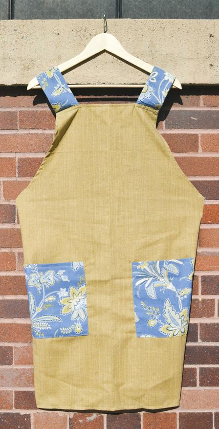 Smock apron created by Haleema and Marziye at Fancy Bridal & Alterations, a business developed with the help of the International Rescue Committee