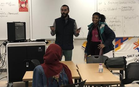 Milad Hosseini-Mozari, a Utah artist, teaches the International Rescue Committee's New Americans in Action student group about sound collage.