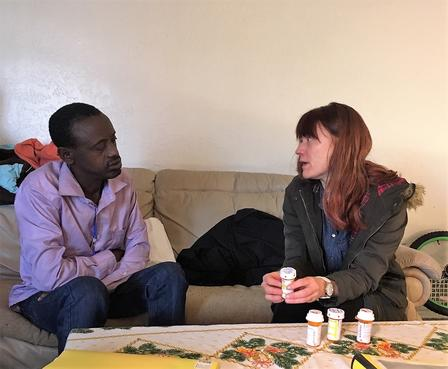Erica, a health mentor with the International Rescue Committee in Salt Lake City, meets with a newly arrived refugee.