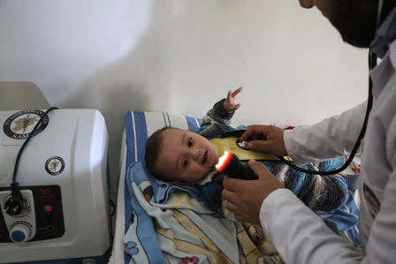 Syrian baby being treated at a children's clinic in Idlib, Syria