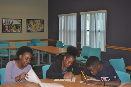 Refugee youth participate in financial literacy education as part of the East African Refugee Goat Project, a project of the International Rescue Committee in Salt Lake City.