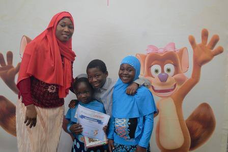An upstart graduate poses with her family during the graduation ceremony at the International Rescue Committee in Salt Lake City.