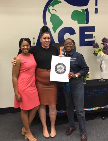 Commissioner Dianne Willams-Cox and Courtney Thomas from the Office of Mayor John Dailey presented an official World Refugee Day Proclamation to IRC Site manager, Una Bilic.