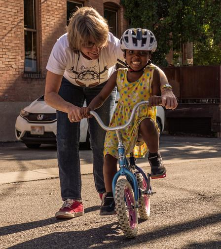 The International Rescue Committee in Salt Lake City receives donations from community members and organizations, including the Bicycle Collective, to ensure that newly arrived refugees are able to survive and thrive in their new community.