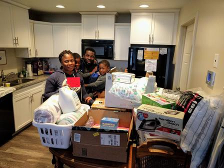 Refugee family receives gifts during the International Rescue Committee in Salt Lake City's annual holiday drive.