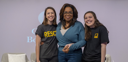 Camille André, who spoke with Oprah Winfrey about the IRC's work aiding asylum-seeking families on the US-Mexico border, with Oprah and IRC colleague Hope Arcuri in Phoenix, Ariz. in Feb. 2020.