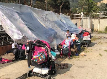 A line of strollers are used to create a makeshift tent on the Bogotá-Chia highway.