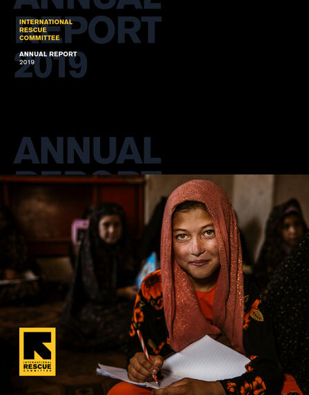 Cover of IRC 2019 annual report featuring a photo of a girl in a classroom