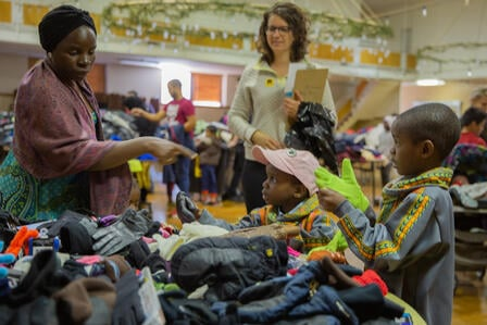 Newly arrived refugees pick out winter clothing at IRC in Salt Lake City's Warm Welcome Winter Clothing Drive