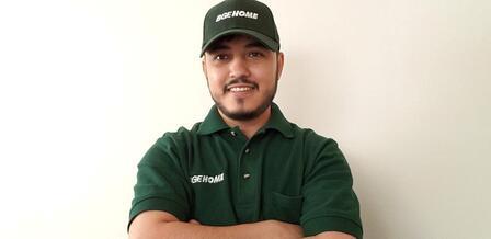 Photo of Mohammad Bashir Temori working as an HVAC technician.