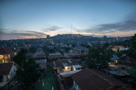 An aerial view of a hilly neighborhood in Kampala, Uganda just after sunset