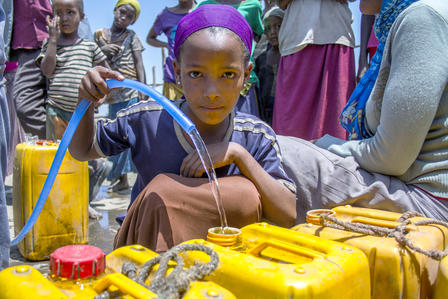 Shita Serbela collects water in Ethiopia.
