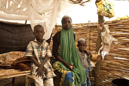 A family in their thatch home in Yola.