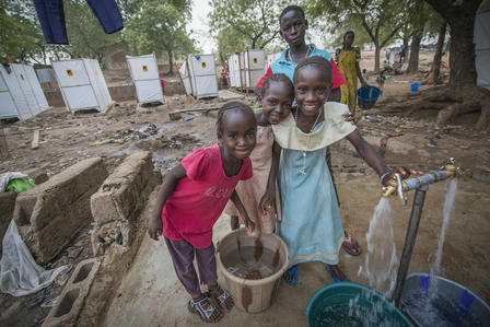 Girls fetch water at an IRC-installed pump