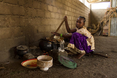 Nigerian girl in Cameroon cooks dinner