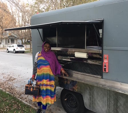 Chef Kaltum of Mother of All stands with Food Truck