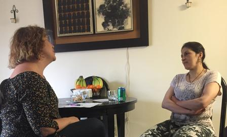 ESL Tutor practice English with refugee as part of new International Rescue Committee program