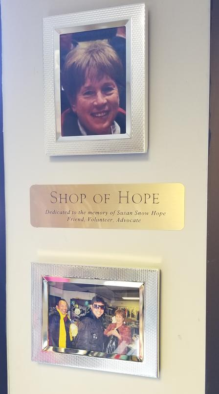 Shop of Hope dedication plaque and photographs to remember and honor Susan.