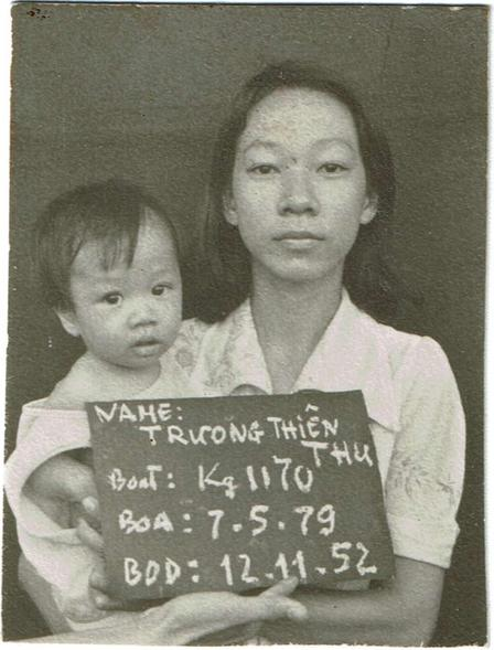 Kathy Tran at 7 months old, being held by her mother in a Malaysian refugee camp