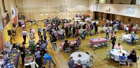 The hall starts to fill as people get ready to eat!