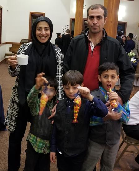 Moustafa family poses at Breaking Bread dinner.