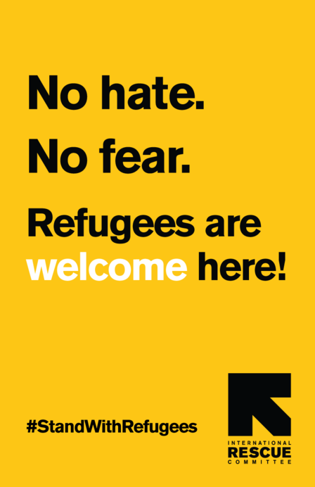 "Posted reads: ""No hate. No fear. Refugees are welcome here! #StandWithRefugees"""