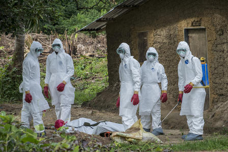 A burial team in Liberia about to carry away the body of a man suspected of having died from the Ebola outbreak in 2014.