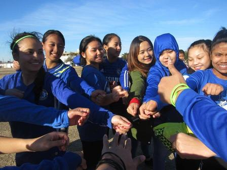 Eh Kaw and her soccer team from Emmett J Conrad High School