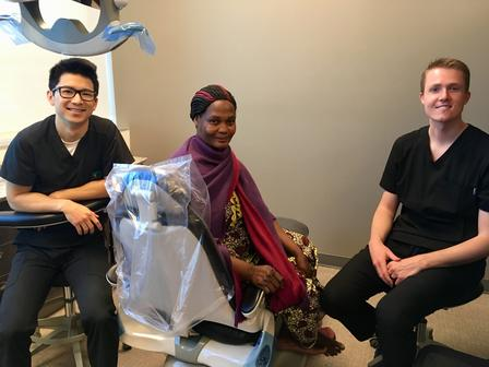 Refugee woman waiting to receive much-needed dental care through Share a Smile event