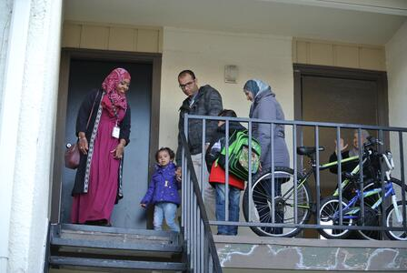 A Syrian family on the landing of their new apartment in Dallas