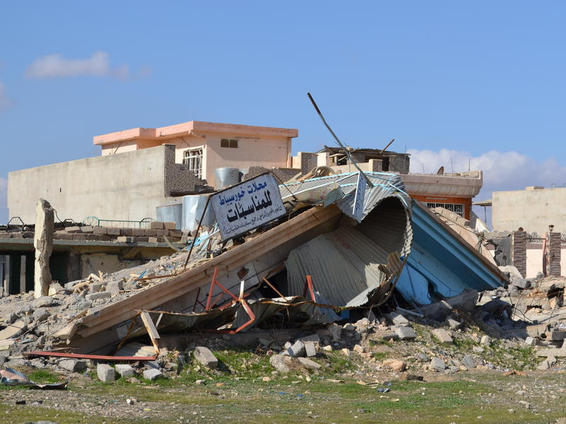 The collapsed ruins of  a shop in Khorsebat, a village that was heavily damaged during the battle to retake the nearby city of Mosul from ISIS