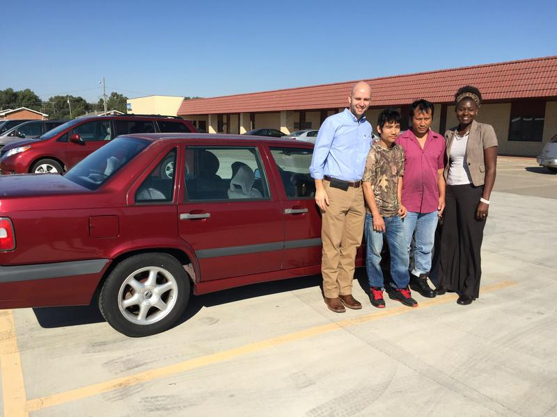IRC staff member Amy Longa (right) with a refugee family who received a car donation
