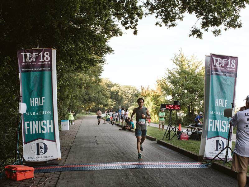 Ethiopian runner Tolassa Elemaa crosses the finish line of a half marathon in Dallas, Texas