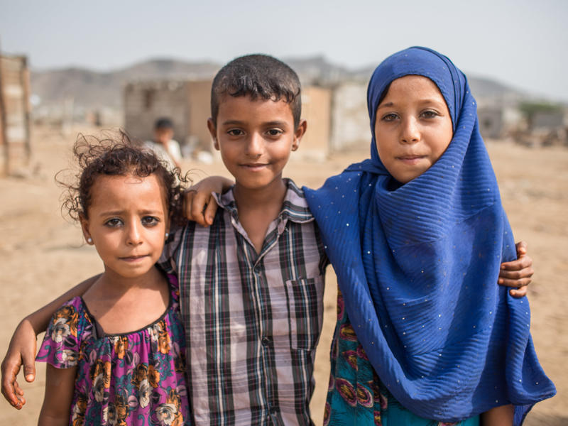 Children play with their friends in front of their home in Al Buraiqeh, a village on the outskirts of Aden, Yemen.