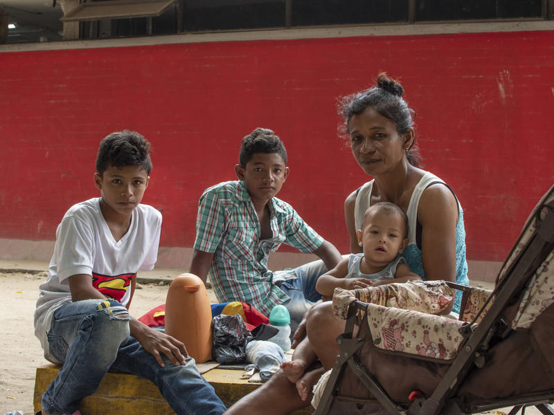 A Venezuelan mother and her three children living on the street in Bogota, Colombia