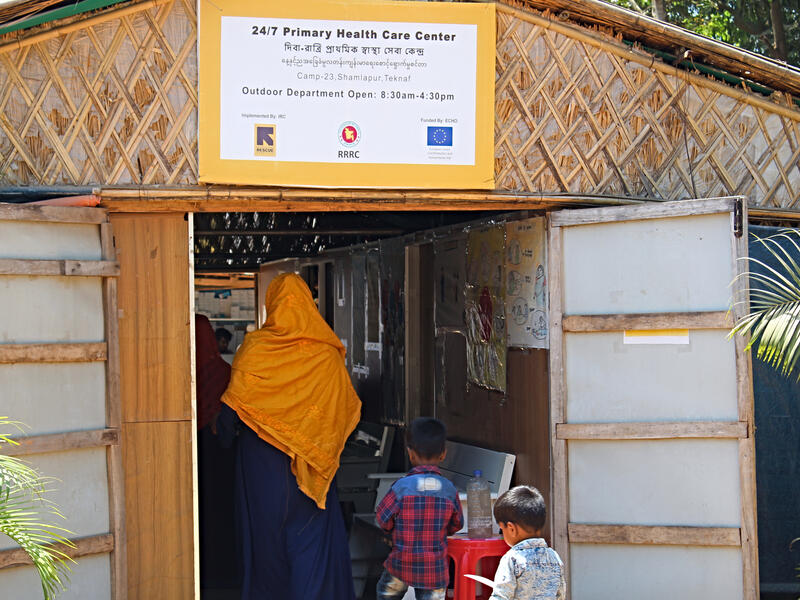 Sakera Akter and her two young sons enter the IRC's primary health care center in Cox's Bazar