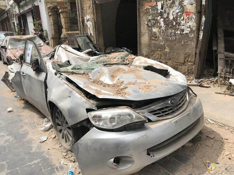 A parked car smashed by falling debris in the Beirut explosion