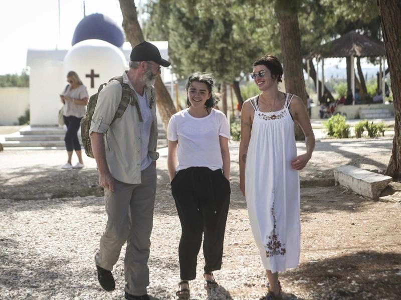 """Game of Thrones"" actors Liam Cunningham, Maisie Williams and Lena Headey walk through a refugee settlement where the IRC works in Greece."