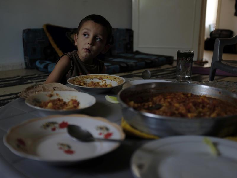 Boy eating a healthy dinner in Jordan