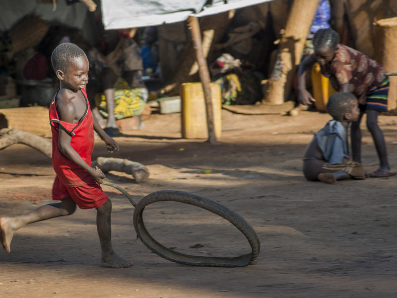 A boy plays in a makeshift camp in Kaga Bandoro
