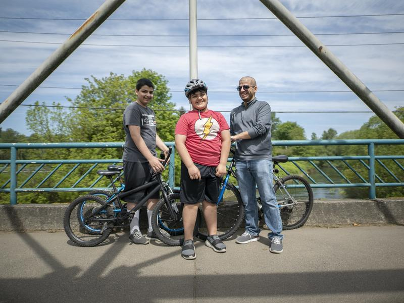 Yousif rides his bike with his brother, Ali and father in Seattle