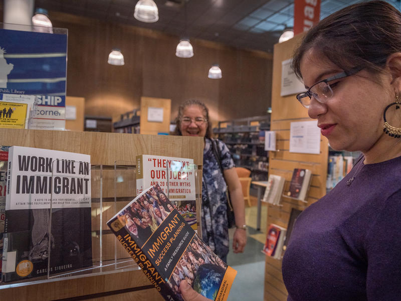 Salvadoran mom and daughter at local book store in San Jose