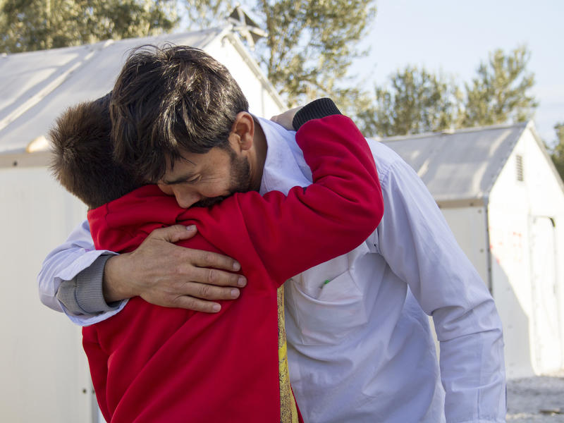 Afghan refugee father is reunited with his son.
